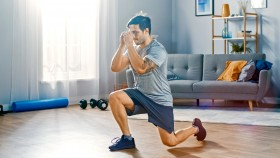 Male-Performing-Split-Squat-In-Living-Room-Home-Gym thumbnail