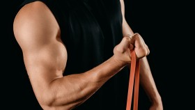 Male Perform Bicep Curl Exercise With Band thumbnail