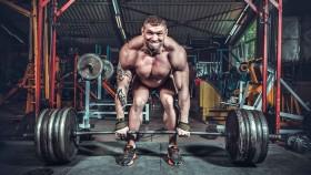 Man deadlifting 495 pounds thumbnail