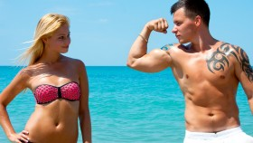 Man-Flexing-Girl-Beach thumbnail