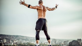 Man-Stretching-Out-Arms-Back-839963076 thumbnail