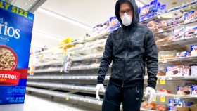 Man-Wearing-Coronvirus-N95-Face-mask-While-Shopping-For-Cereal-At-A-Grocery-Store thumbnail