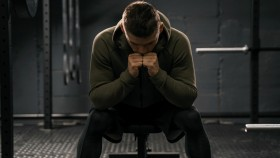 Man-Wearing-Hoodie-In-Gym-Stressed-Out-Worried thumbnail