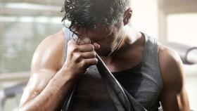 Man-Wiping-Sweat-With-Shirt thumbnail