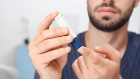Man-With-Beard-Pricking-Finger-For-Blood-Diabetes-Test thumbnail