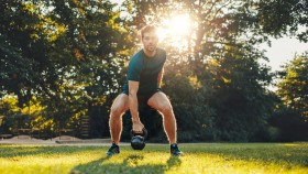 Man-Working-Out-With-Kettlebell-Outdoors-in-the-Park thumbnail