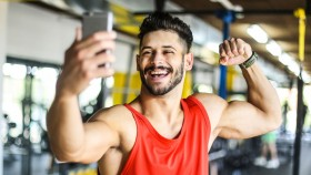 Man taking selfie in gym thumbnail