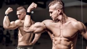 Muscular-Man-Flexing-Bicep-In-Mirror thumbnail