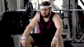 Overweight-Man-Sitting-Down-At-Bench thumbnail