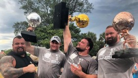 Martins Licis hoists up his 2019 World's Strongest Man trophy in Bradenton, Florida.  thumbnail
