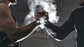 Two-Males-Grasping-Smokey-Hands thumbnail