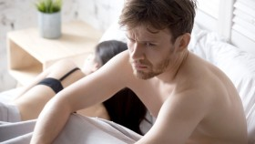 Upset-Guy-In-Bed-Next-To-Lying-Girlfriend thumbnail
