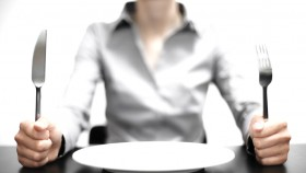 Woman-Holding-Knife-Fork-Empty Plate thumbnail