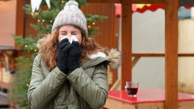 Woman sneezing in cold weather thumbnail