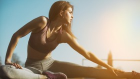 Young-Fitness-Female-Stretching-Legs-In-Sunset thumbnail
