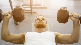 Young-Male-Focused-Performing-Lying-Dumbbell-Chest-Press thumbnail