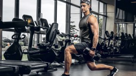 Young-Muscular-Man-Doing-Lunges-In-Dark-Gym thumbnail