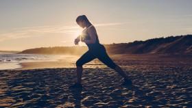 Woman Stretching on Beach thumbnail