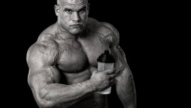 man holding protein drink thumbnail