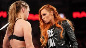 Becky Lynch staring down Ronda Rousey.  thumbnail