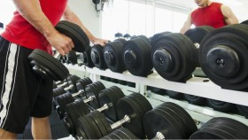 man as dumbbell rack thumbnail