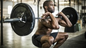 man performing barbell front squat exercise thumbnail