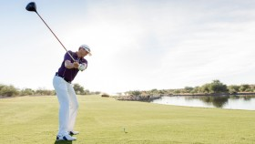 Man Swinging Golf Club thumbnail