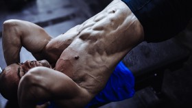 Man exercising abs in the gym thumbnail