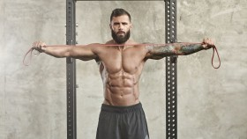 Athletic Man Doing Resistance Band Pull-apart thumbnail