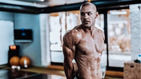 Man Showing His Muscles in the Gym  thumbnail