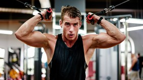 Man In The Gym Doing a Cable Exercise thumbnail
