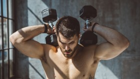 Man Exercising With Dumbbells  thumbnail
