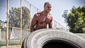 Shirtless Man Workout With Tire thumbnail