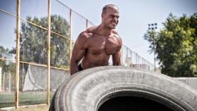 Shirtless Man Workout With Tire thumbnail