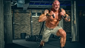 Strong Muscular Men pulling big tire with ropes thumbnail