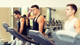Men Running on the Treadmill in the Gym thumbnail
