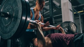 Man Bench Pressing With a Spotter  thumbnail