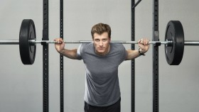 man standing at squat rack with barbell thumbnail