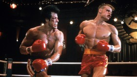 Sylvester Stallone punches Dolph Lundgren in a scene from the film 'Rocky IV', 1985. thumbnail