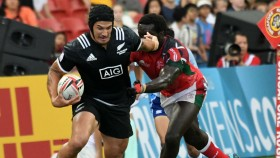 New Zealand's Trael Joass (L) runs with the ball against Kenya during the fifth place cup semi-final of the HSBC Singapore Rugby Sevens tournament in Singapore on April 29, 2018. thumbnail