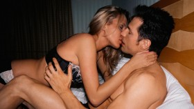 Couple kissing in bed thumbnail