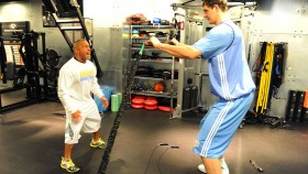 Strength and conditioning coach Steve Hess works with Timofey Mozgov #25 of the Denver Nuggets during the first day of training camp on December 9, 2011 at the Pepsi Center in Denver, Colorado. thumbnail