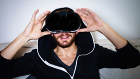 Man Using Virtual Reality Headset thumbnail