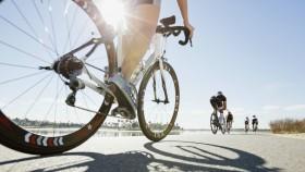 Woman riding bike thumbnail