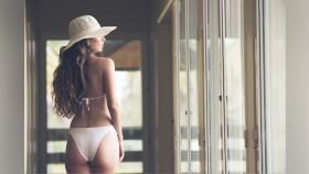 Woman in White Bikini thumbnail