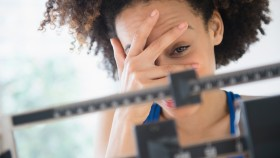 Woman Displeased With Weight thumbnail
