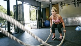 Woman Doing Battle Ropes at the Gym thumbnail