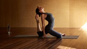 Woman Practicing Yoga thumbnail
