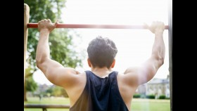 Man doing pullups outdoors in park thumbnail