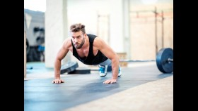 Man performing pushup in gym thumbnail